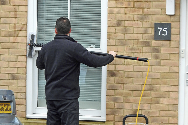 An image of a man cleaning windows